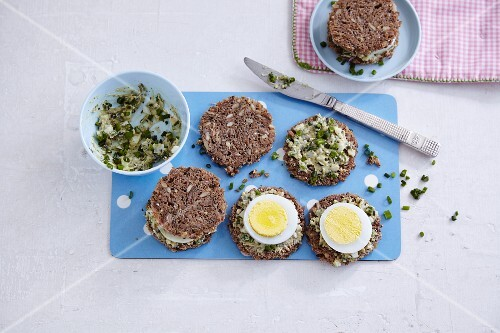 Pumpkin seed bread with a herb spread and hard-boiled eggs