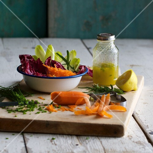 Salad with a jar of vinaigrette