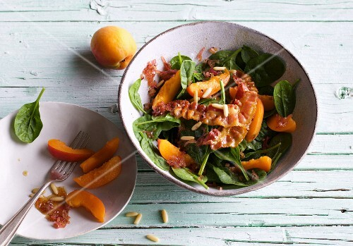 Spinach and apricot salad with fried bacon