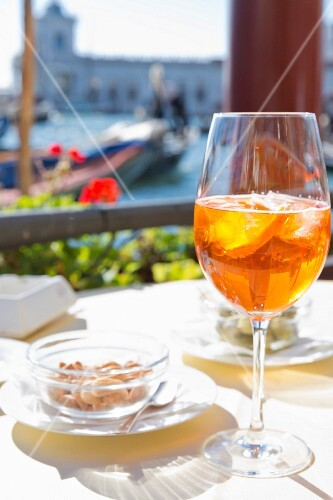 Aperol Spritz on the terrace of the Monaco Hotel on the Canal Grande, Venice, Italy