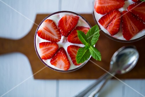 Layered strawberry deserts in glasses