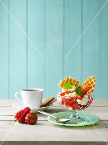 Strawberries with waffles and ice cream