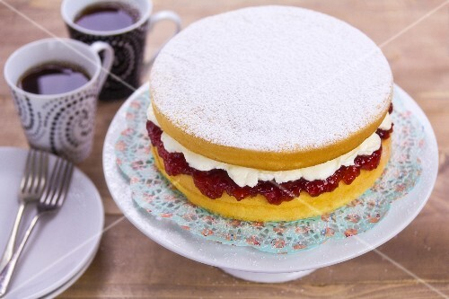 A sponge cake with a cream and jam filling