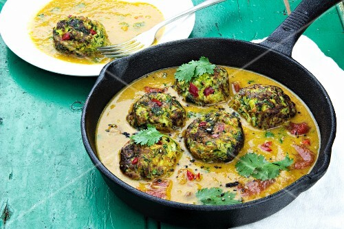 Courgette fritters in a curry sauce