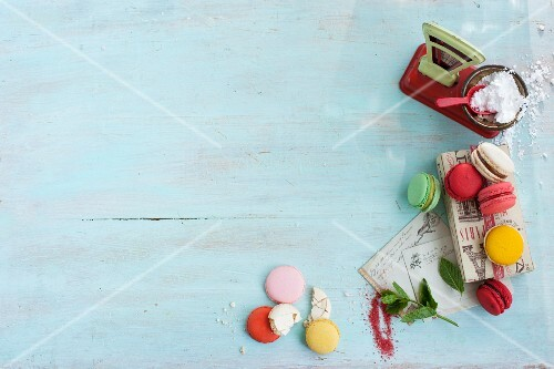Various macaroons with a pair of toy scales