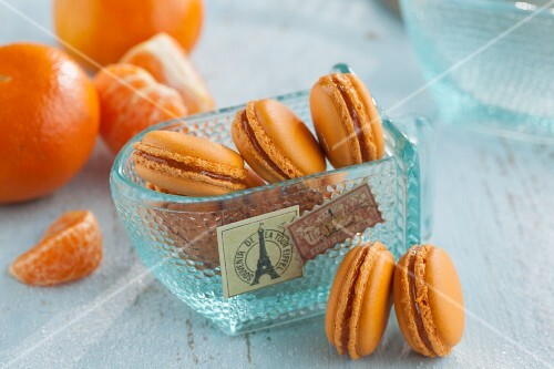 Mandarin macaroons in a glass scoop