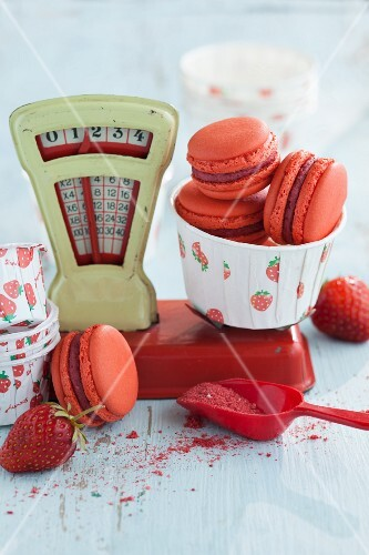 Strawberry macaroons on a pair of old toy scales