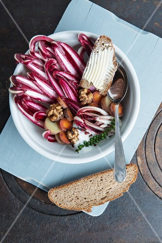 Radicchio salad with Cherie potatoes, primaeval carrots, roasted walnuts, yoghurt and Thai green pepper