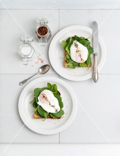 Toast topped with young spinach and poached egg