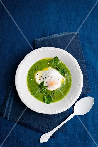 Watercress soup with a poached egg
