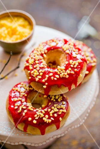 Doughnuts with red icing and nut brittle