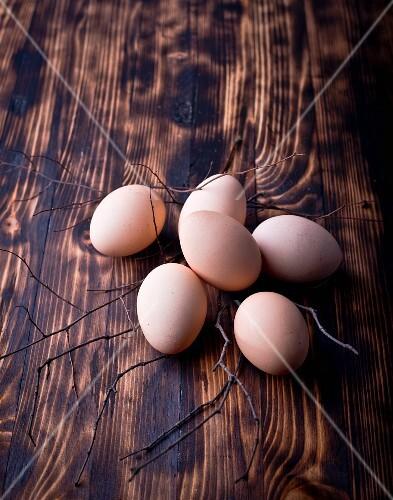 Fresh eggs on a dark wooden surface