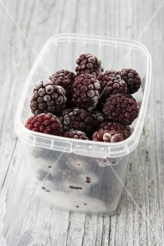 Frozen blackberries in a plastic container
