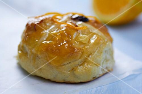 Hot cross bun with a marmalade glaze
