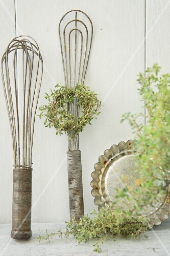 Kitchen utensils with a wreath of thyme