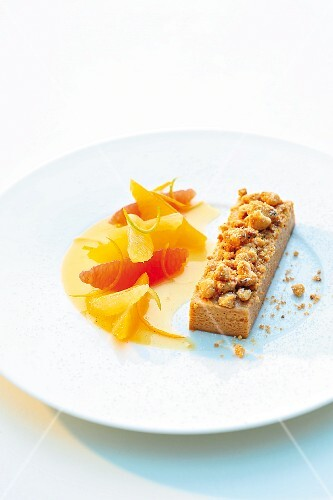 Marinated citrus fruits with caramel cream and crumble