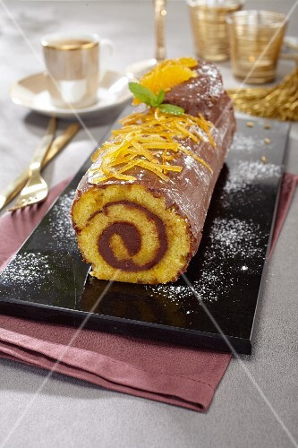 Yule log with oranges and milk chocolate