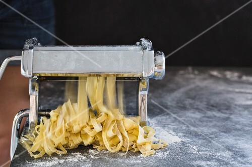 Homemade fresh tagliatelle with a pasta machine