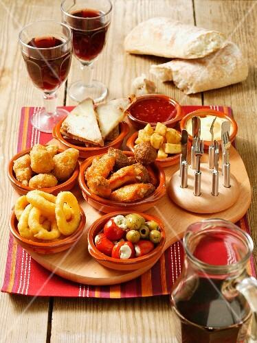 An arrangement of various tapas on a serving board
