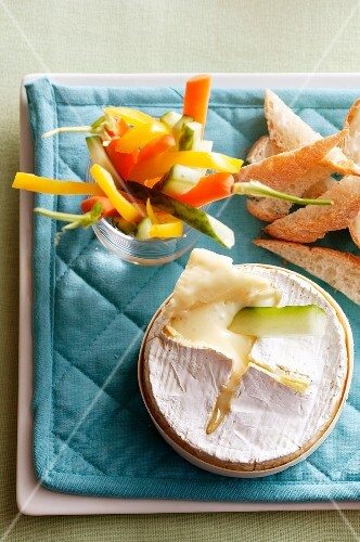 Oven-baked camembert with vegetable crudites for dipping