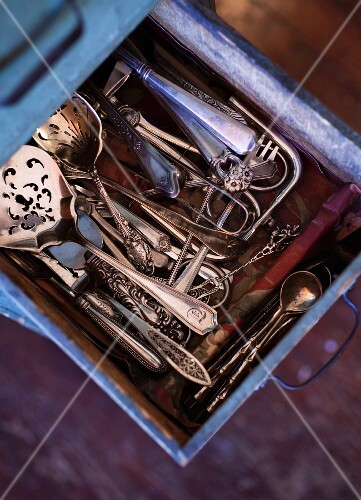 Old silver cutlery in drawer