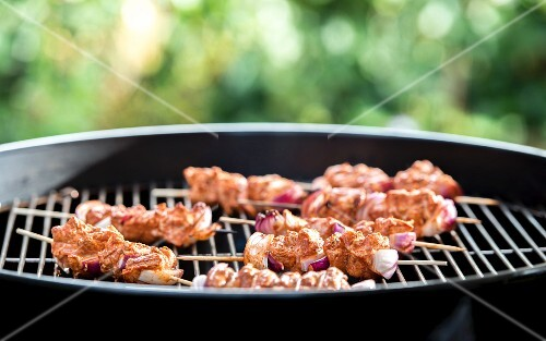 Tandoori chicken skewers on a barbecue