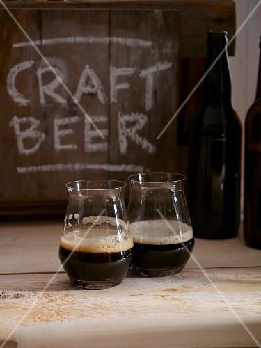 Two glasses of dark beer