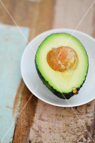 Half an avocado on a plate