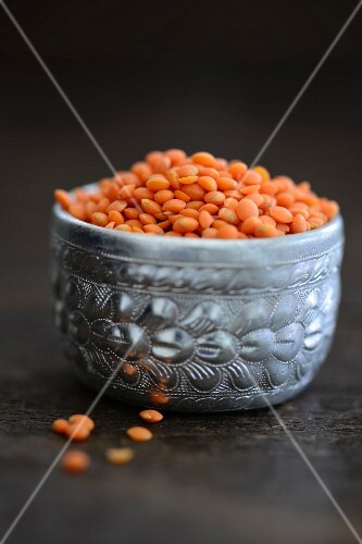 Red lentils in a silver bowl