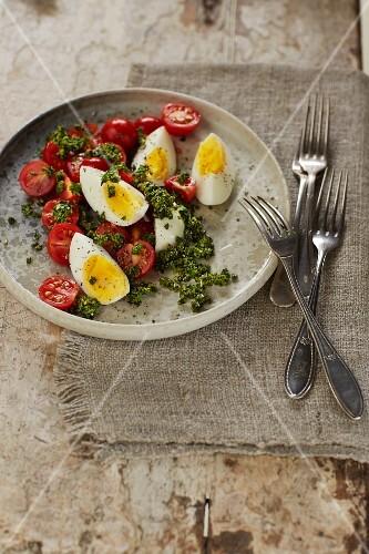 Tomato and egg salad with pumpkin seed pesto