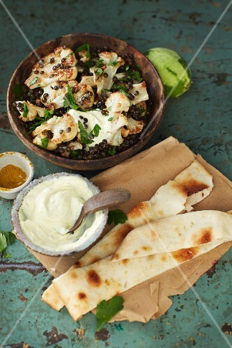 Roasted cauliflower salad with beluga lentils and spicy yoghurt