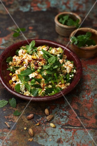Oriental bulgur salad with feta cheese, mint and harissa dressing