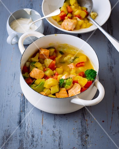 Potato soup with salmon and vegetables