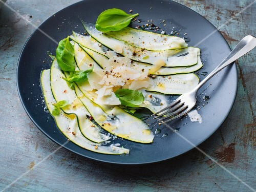 Vegetarian courgette carpaccio with fresh Parmesan cheese