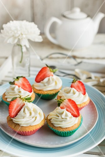 Cupcake with buttercream and strawberries