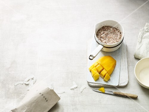 Porridge with flax seeds, chia seeds, nuts, coconut milk and mango (Paleo diet)