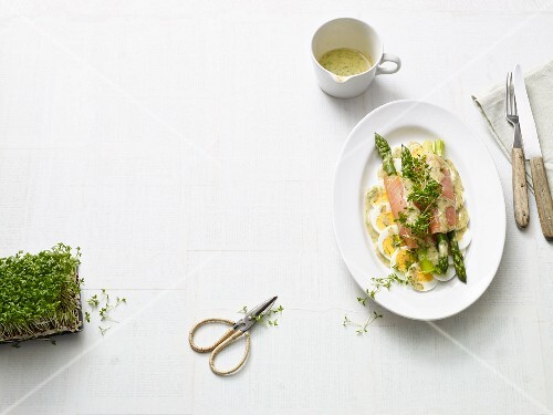 Green asparagus salad with smoked salmon and hard-boiled eggs (Paleo diet)