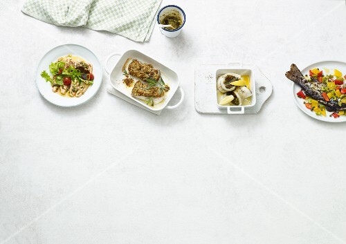 Four oven-roasted fish dishes with spiced ghee (Paleo diet)