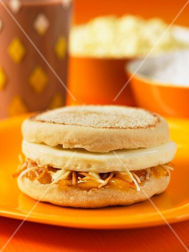 An English muffin with marmalade and Cheddar cheese