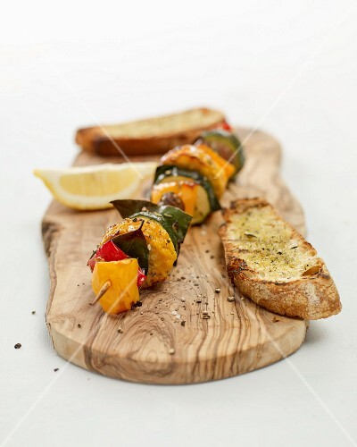 Grilled Mediterranean vegetable skewers with garlic bread