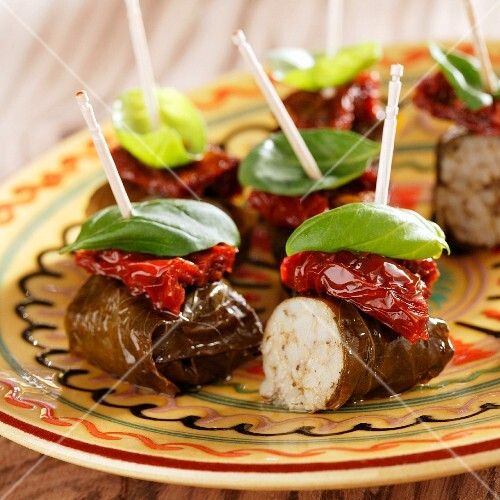 Stuffed vine leaves with dried tomatoes and basil
