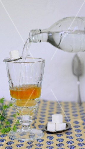 Water being added to a glass of apple vinegar
