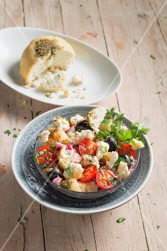 Greek bread salad with vegan almond cheese