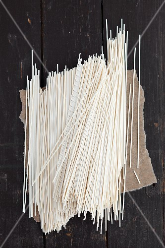 Shanghai noodles on a dark grey wooden table