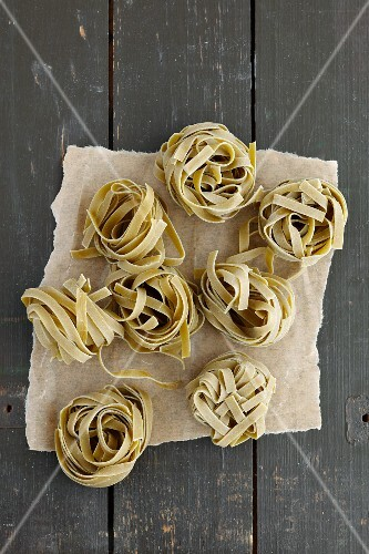 Spinach tagliatelle on a dark grey wooden table