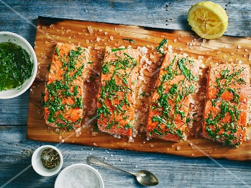 Herb salmon fillet with sea salt grilled on a plank