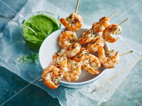 Grilled prawn skewers with green sauce