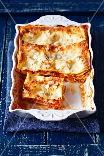Lasagne bologese with courgettes and flaked almonds