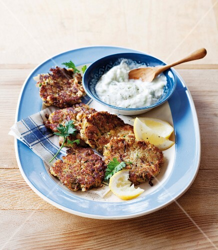 Mackerel and courgette cakes with tzatziki and lemon wedges