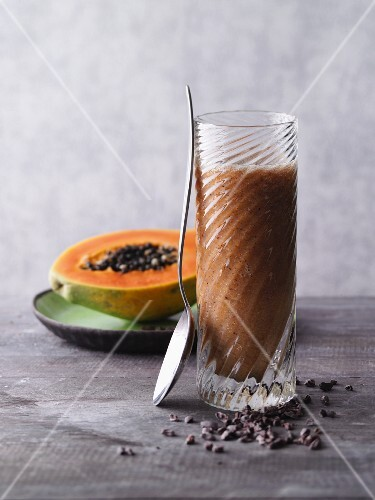 A pineapple and papaya smoothie with physalis and cocoa nibs